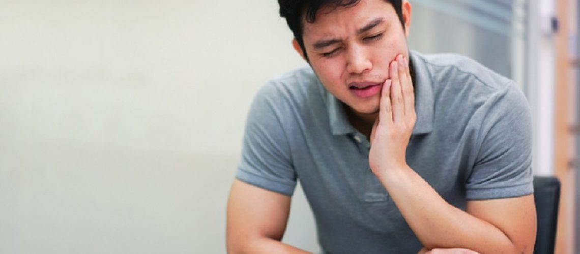 close up asian middle aged man feeling hurt from toothache symptom , unhealthy life concept